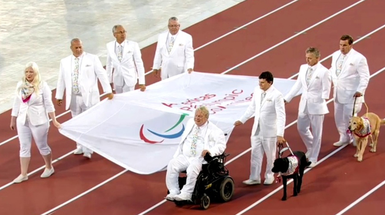 Arnold Boldt carries flag at Parapan Am Games