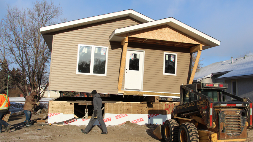 Second Sask Polytech, Habitat for Humanity home is moved to permanent location
