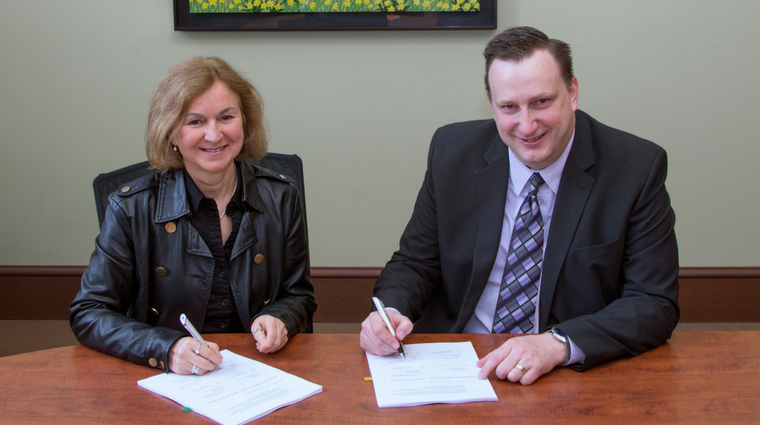 Image Credit: Saskatchewan Polytechnic (Paul Carter signing an agreement with NBCC)
